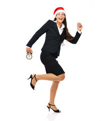 Business woman with santa hat is running late