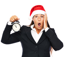 Business woman wearing santa claus hat is late
