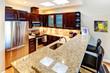 Beatufiful morern dark cabinet kitchen.