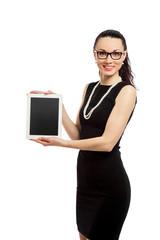 brunette girl in black dress holding ipad
