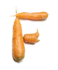 Alphabet letter F arranged from fresh carrots isolated