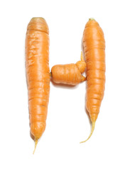 Alphabet letter H arranged from fresh carrots isolated
