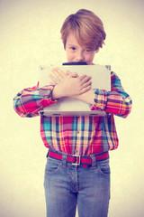 Avaricious boy holding a briefcase
