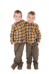 two little boys standing together