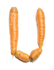 Alphabet letter U arranged from fresh carrots isolated