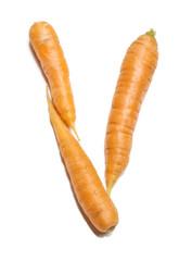 Alphabet letter V arranged from fresh carrots isolated