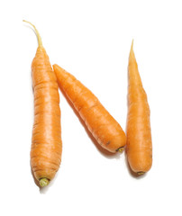 Alphabet letter N arranged from fresh carrots isolated