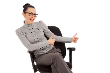 woman sitting in office chair presenting something