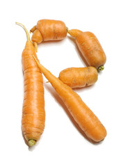 Alphabet letter R arranged from fresh carrots isolated