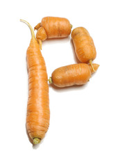 Alphabet letter P arranged from fresh carrots isolated