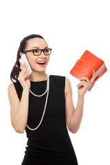 businesswomen holding notebook talking on the phone