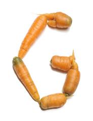 Alphabet letter G arranged from fresh carrots isolated