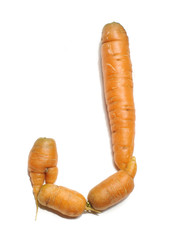 Alphabet letter J arranged from fresh carrots isolated