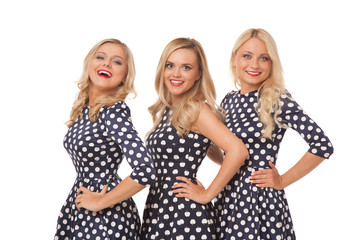 three blonde girl in dot dresses and red lipstick