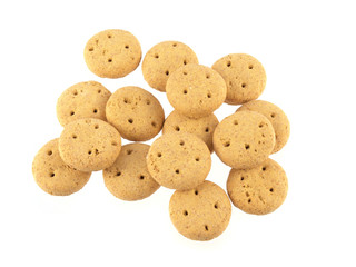 Close up of round dog biscuits on a white background.