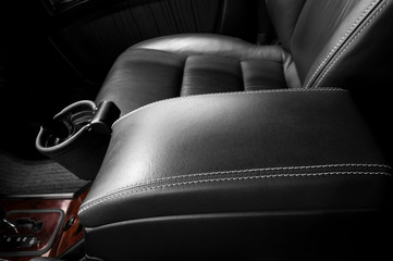 Auto interior detail. Leather armrest.