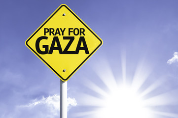 Pray for Gaza road sign with sun background