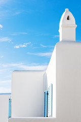 Typical cycladic style chimney on white house in Mykonos