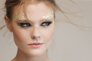 Fashion woman - beauty gilded golden make-up