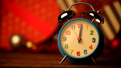 Retro alarm clock and chritmas gifts on background