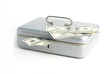 Money box loaded with dollars