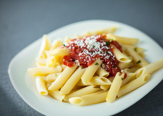 Penne rigate pasta with spicy sauce