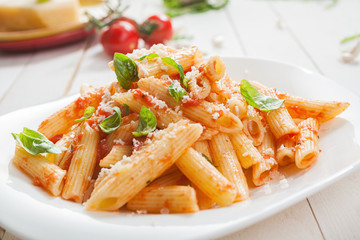 Serving of spicy savory italian penne pasta