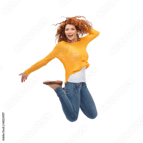 smiling young woman jumping in air - 68224197