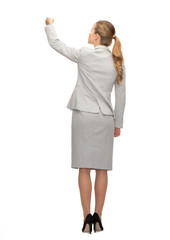 businesswoman or teacher with marker from back