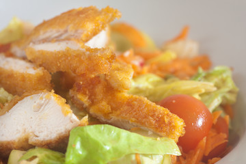 Cornflake crusted chicken pieces served with vegetable salad