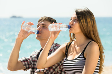 Young couple drink water