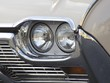 Scheinwerfer eines amerikanischen Sportwagen der Sechziger Jahre