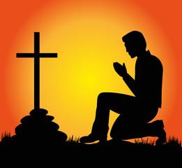 uomo che prega al tramonto
