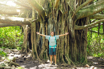Man standing in front of incredible banyan tree
