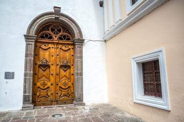 Wooden door and window of the Sagrario church