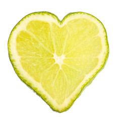 Slice of lime in shape of heart, isolated on white