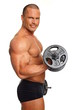 Muscular man exercises with dumbbells on isolate background