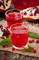 Fresh ripe pomegranate and juice