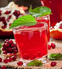 Fresh ripe pomegranate and juice