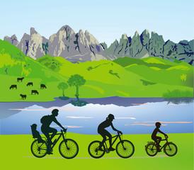 Eltern mit Kindern beim Fahrradfahren