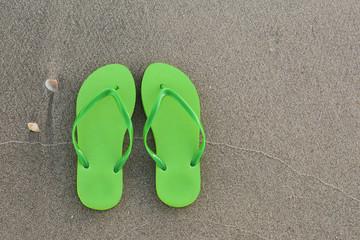 flip-flops on the black sand