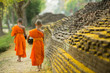 Leinwanddruck Bild - Buddhist Monk walking for receive food