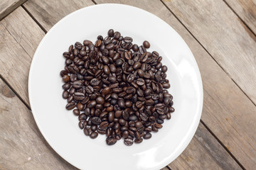 Coffee beans on a wooden table..