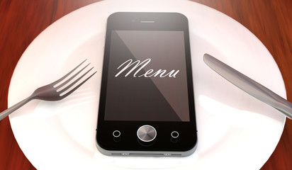 Mobile phone with menu text, on plate with fork and knife