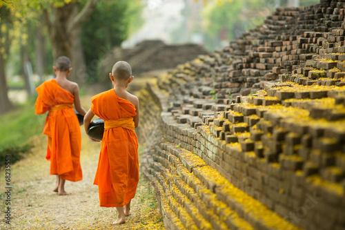 Leinwanddruck Bild Buddhist Monk walking for receive food