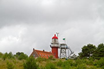 Red lighthouse on dutch island Vlieland