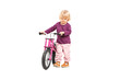 Baby girl pushing a small bike