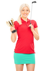 Female golfer holding a golden trophy