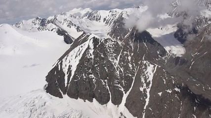 Stock Video Footage Alpine Flying Snow and tops Glacier