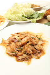 Thai cuisine spicy pork salad , Moo Nam Tok isolated white backg